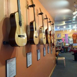 Guitars fill the entrance hall